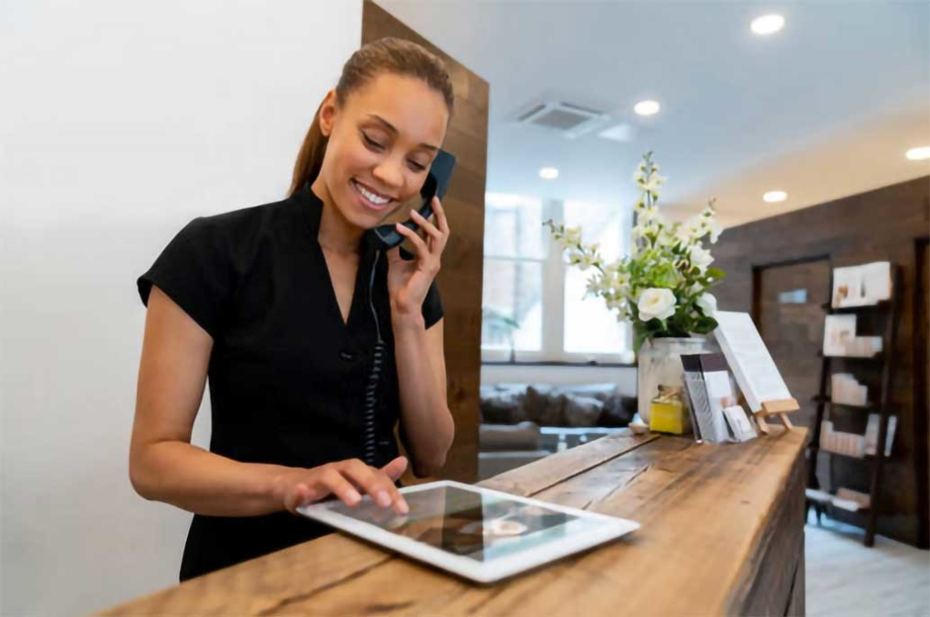 receptionist using tablet